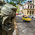 A Bronze Lion Guards Historic Buildings by Melissa Roldan