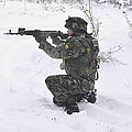 A Bulgarian Soldier Aims Down The Sight by Stocktrek Images