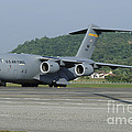 A C-17 Globemaster IIi Of The U.s. Air by Remo Guidi