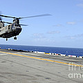 A Ch-47 Chinook Helicopter Landing by Stocktrek Images