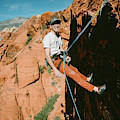 A Climber On Panty Wall In Red Rock by Ryan Tuttle