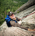 A Climber Reaches His Hand In A Crack by Kevin Steele
