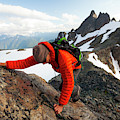 A Climber Scrambles Up A Rocky Mountain by Christopher Kimmel