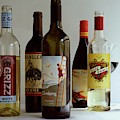 A Collection Of Wine Bottles by Romulo Yanes