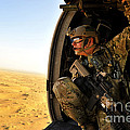 A Combat Rescue Officer Conducts by Stocktrek Images