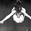 A Contortionist On A Pedestal by Underwood Archives