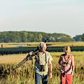 A Couple Bird Watching On A Salt Marsh by Jerry Monkman