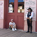A Dog And A Re-enactor Rest In The Front Of The Bird Cage Theater Tombstone Arizona by David Lee Guss