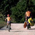 A Father And Son Ride Their Bikes To Go by Corey Rich