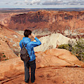 A Female Hiker Looking by Ron Koeberer