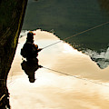 A Fly Fisherman Standing In A River by Rob Hammer
