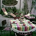 A Garden Set Up For Lunch by Tom Leonard