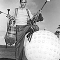 A Golfer With A Giant Ball by Underwood Archives