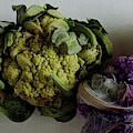 A Group Of Cauliflower Heads by Romulo Yanes