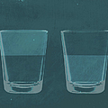 A Half Full Glass Of Water Next To A by Malte Mueller