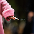 A Hand Holding A Cigarette by Ron Koeberer