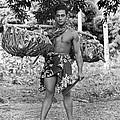 A Hawaiian With Coconuts by Underwood Archives