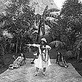 A Hawaiian Woman Dancing by Underwood Archives