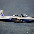 A Hellenic Air Force T-6 Trainer Flying by Timm Ziegenthaler