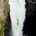 A Kayaker Takes The Plunge On Huge by Lucas Gilman