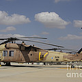 A Line Of Uh-60l Yanshuf Helicopters by Ofer Zidon
