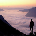 A Lone Hiker Above The Clouds by Cliff Leight