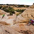 A Male And Female Mountain Biker Ride by Dan Barham