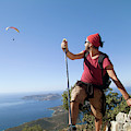 A Male Climber Looking At Paragliding by Me Studio