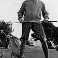 A Male Model Posing As A Golfer Wearing by Leonard Nones