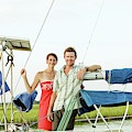 A Man And A Woman Embrace In Sailboat by Eyeconic Images