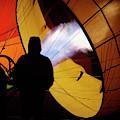 A Man As He Inflates A Hot Air Balloon by Ron Koeberer