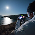 A Man Captures The Full Moon by Kevin Steele