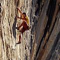A Man Climbing A Big Wall In El Potrero by Corey Rich