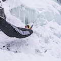 A Man Hangs In A Hammock Sleeping Bag by Bud Force