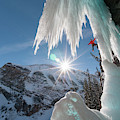 A Man Ice Climbing Louise Falls by Kennan Harvey