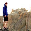 A Man In A Blue Jacket Standing by Jordan Siemens