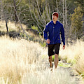 A Man In A Blue Jacket Walks by Jordan Siemens
