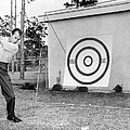 A Man Practices Golf by Underwood Archives