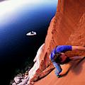 A Man Rock Climbing by Corey Rich