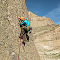 A Man Rock Climbing In Rocky Mountain by Kennan Harvey