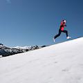 A Man Runs Alone On A Late Winter Day by Corey Rich