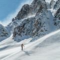 A Man Ski Touring In The Mountains by Whit Richardson