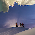 A Man Stands At The Entrance Of An Ice by Alasdair Turner