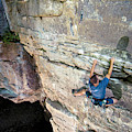 A Man Tackles An Overhanging Sandstone by Andrew Kornylak