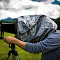 A Man Takes A Photograph With His Large by Kirk Mastin