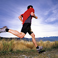 A Man Trail Runs In Salt Lake City by Scott Markewitz