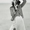 A Model Looking Through A Beaulieu Camera Wearing by Gianni Penati