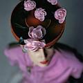 A Model Wearing A Bonwit Teller Hat by John Rawlings