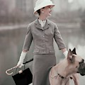 A Model Wearing A Gray Suit With A Dog by Karen Radkai
