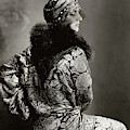 A Model Wearing A Headdress And Brocade Coat